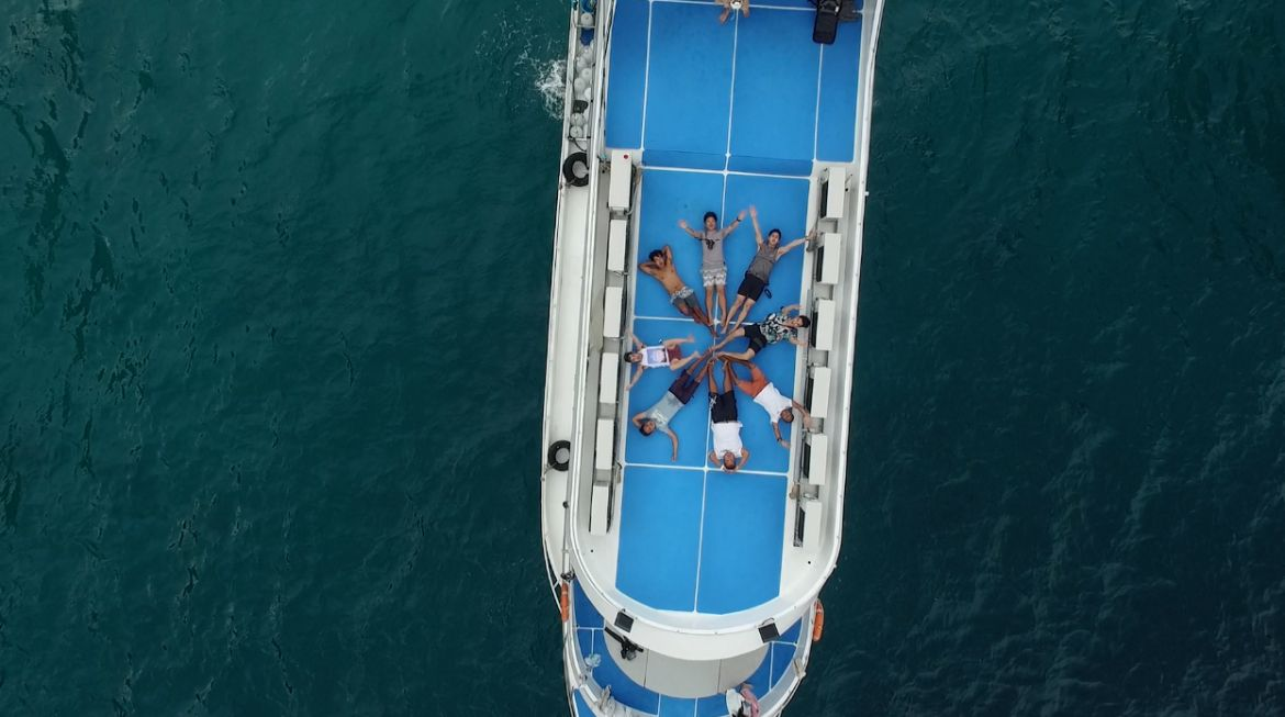 Aerial view sundeck with happy guests