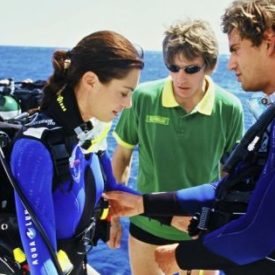 checking dive gear scuba diver student