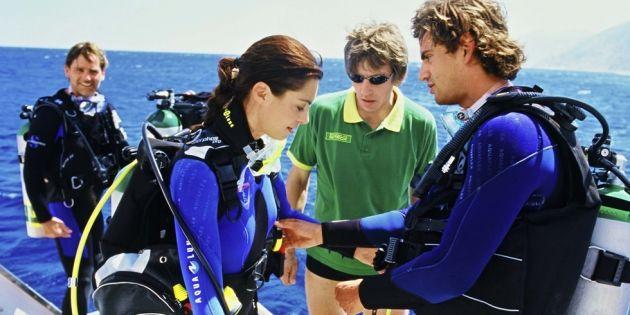 checking dive gear scuba diver student